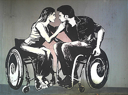 Wheelchair users about to kiss